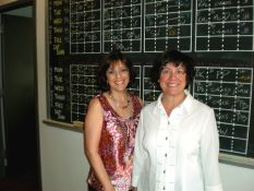 Production Head Claudia Howard and I in front of the Recorded Books session board. All recording sessions are listed by hour. Most narrators can read for an hour; some can do a two-hour session. More than two hours at a stretch is unusual--reading is hard on the voice!